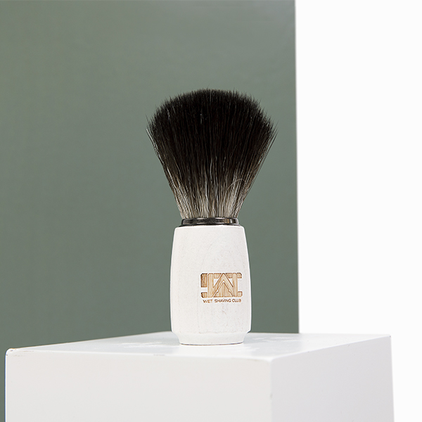 wood handle synthetic shave brush green background