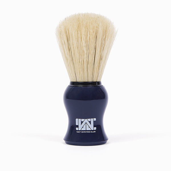 blue shave brush standing