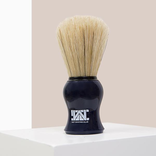 blue shave brush cream background