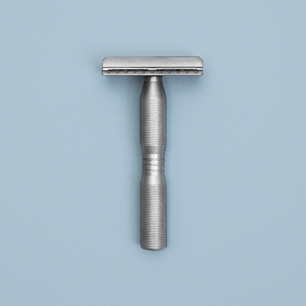 made in the usa safety razor on blue background
