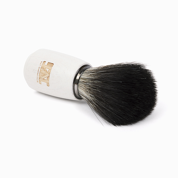 synthetic shave brush laying down