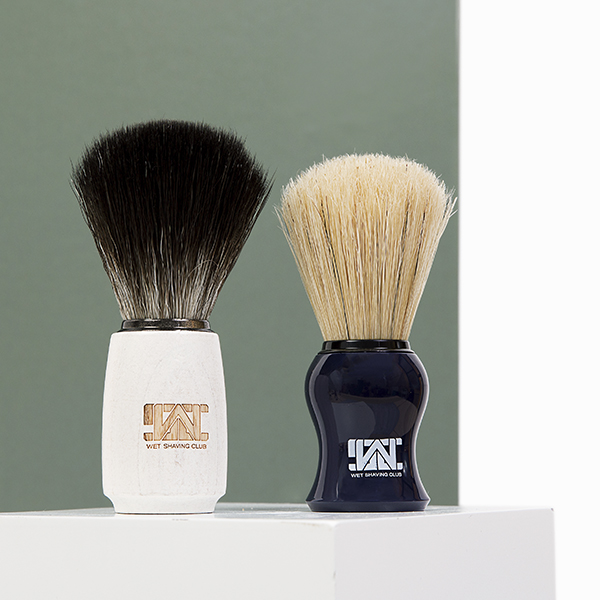 two shave brushes green background